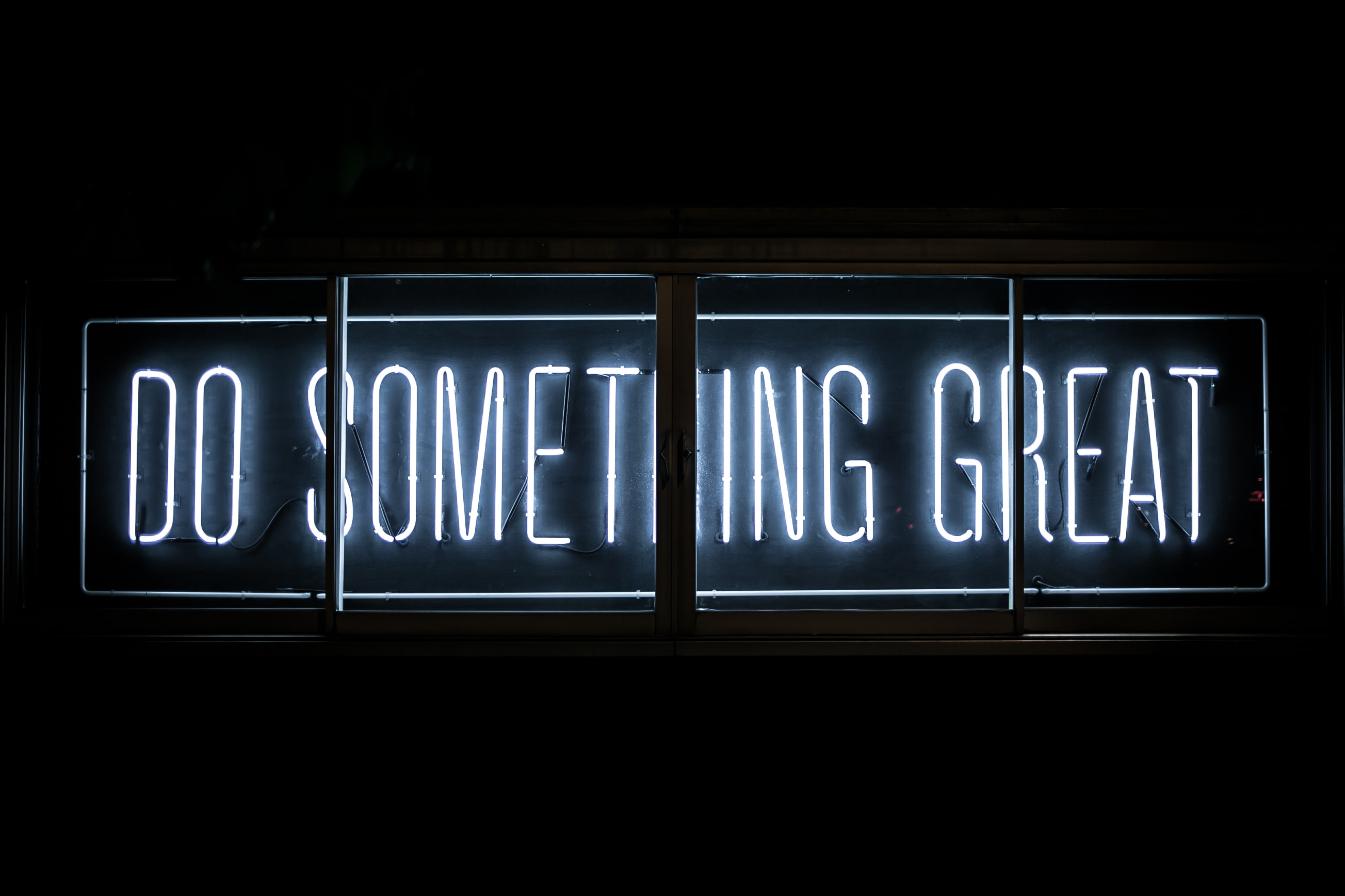 Neon sign saying do something great