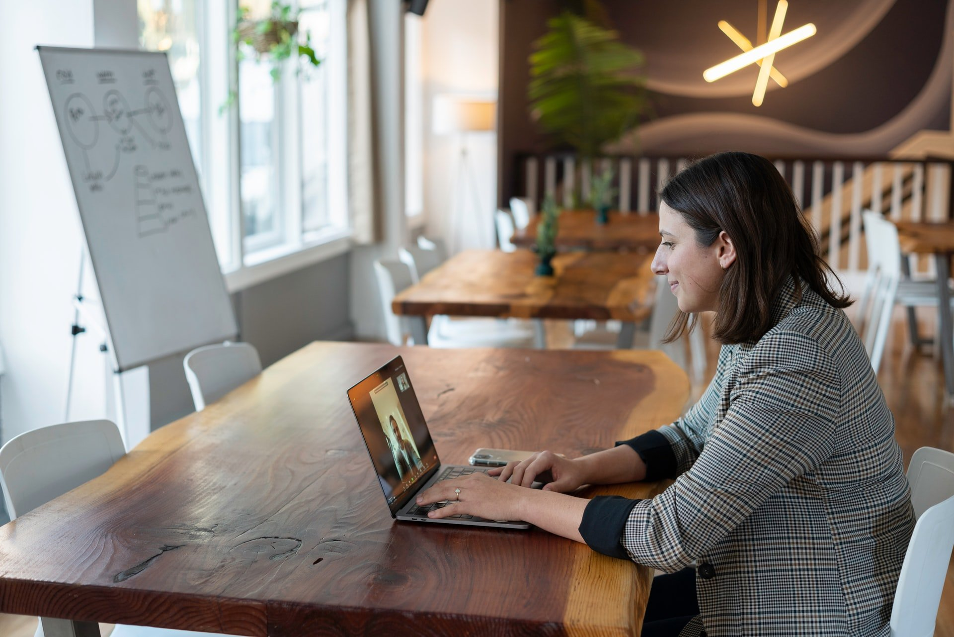 business woman video conferencing on a laptop