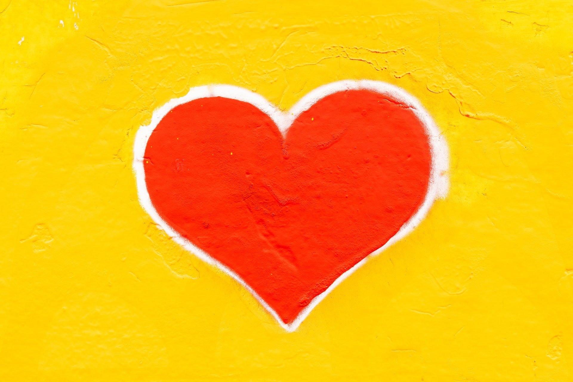 red heart on a yellow background