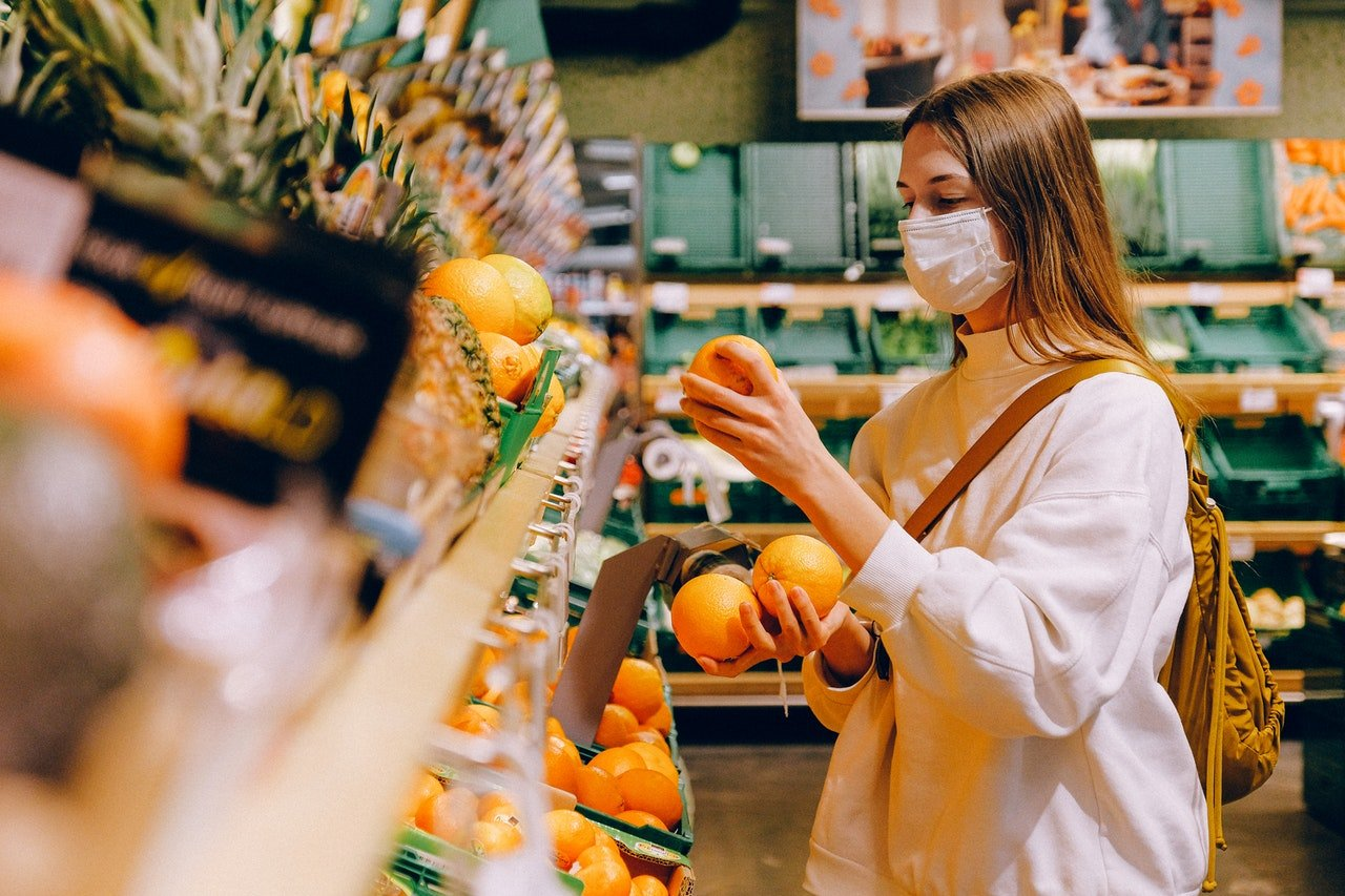 woman wearing medical mask in grocery store