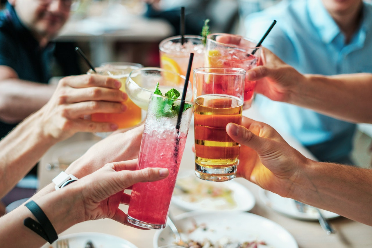 people toasting with different types of beverages
