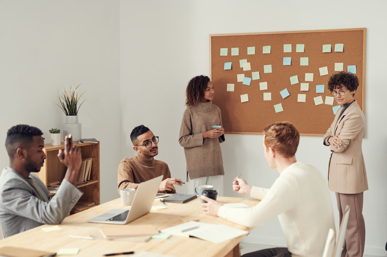Office workers collaborating: knowledge sharing is at the heart of collaboration