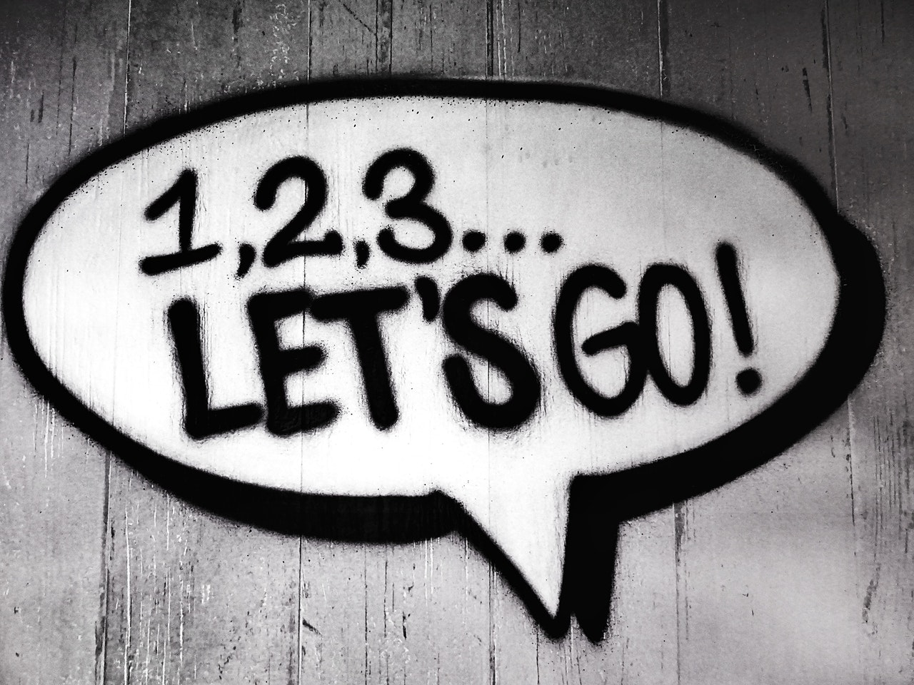 Black and white speech bubble with writing that says 1,2,3...Let's Go!