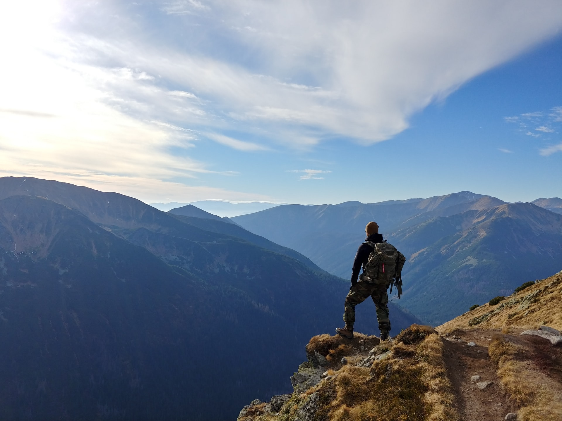 person on a quest overlooking mountains